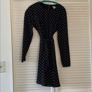 Polka dotted long sleeve dress with a tie belt